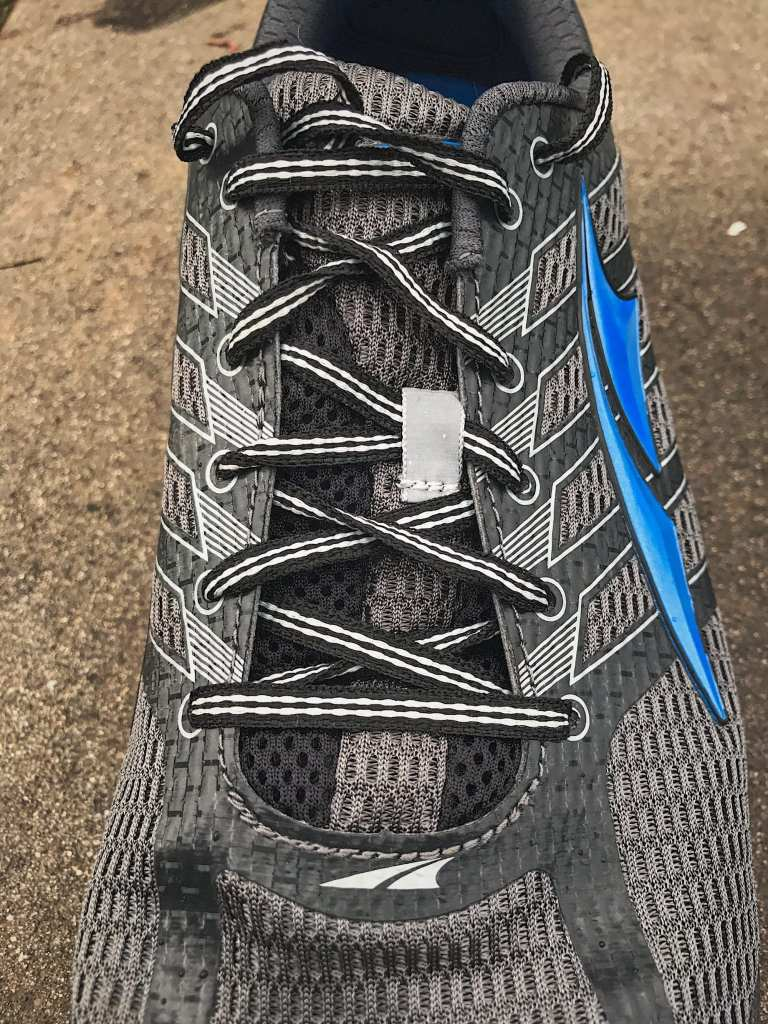 Altra Provision 3.0 contrast lacing closeup. Lots of stitching and overlays.