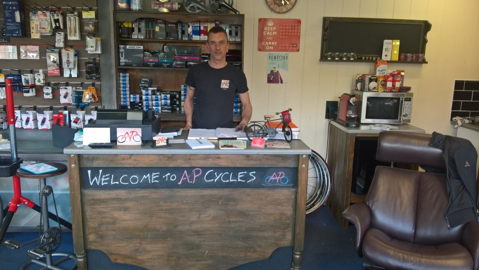 Andy Panks behind the counter at AP Cycles in Norwich