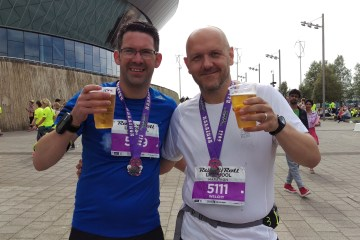 Pete and Jon enjoying a drink after the Liverpool marathon