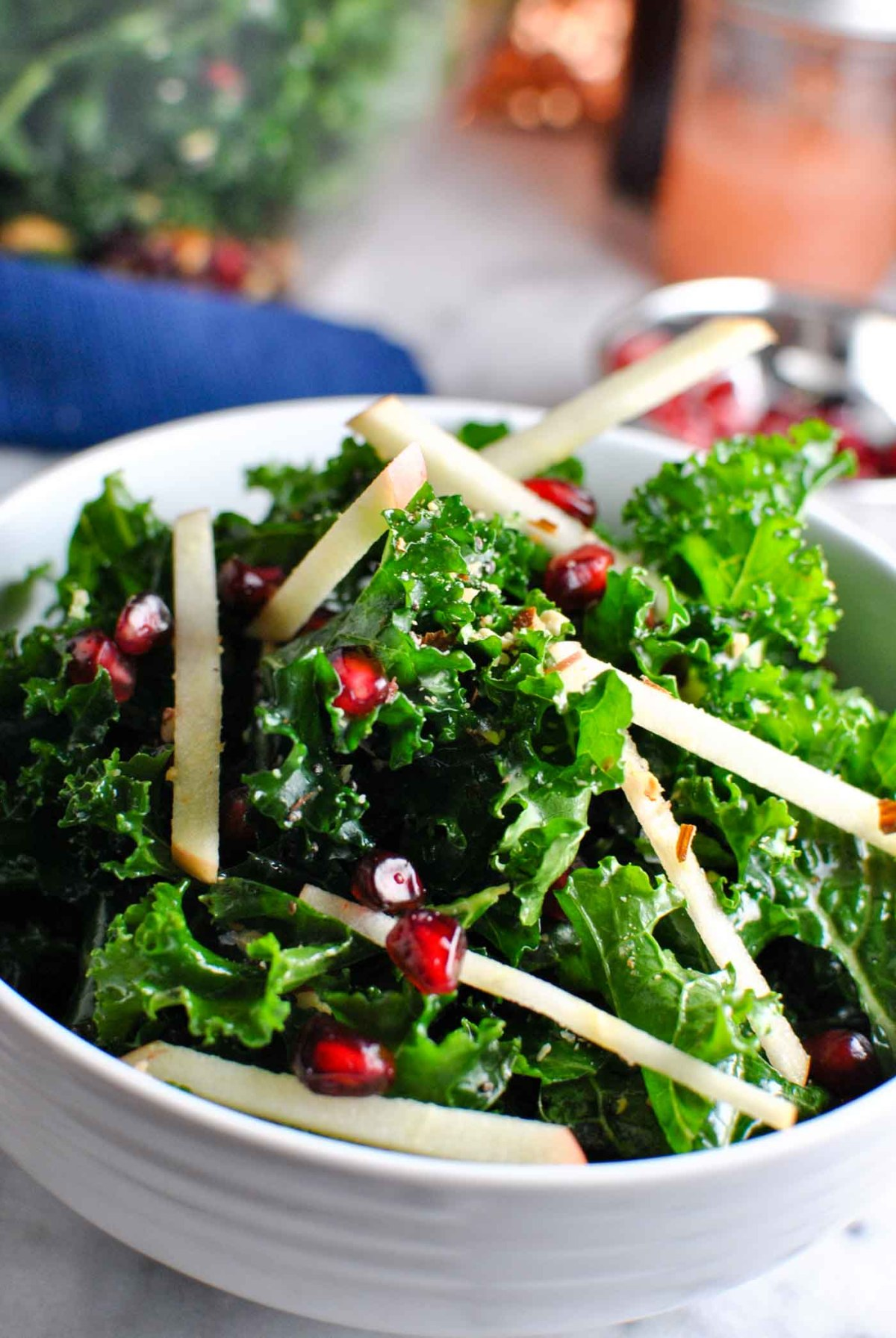 a super easy AND pretty kale apple almond salad! it's perfect for the holidays, i could totally see it as a potluck item or on the dinner table as a healthy side! | thepikeplacekitchen.com