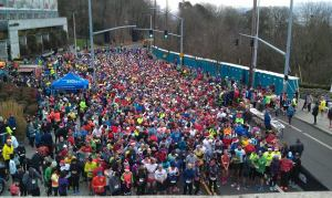 Holiday Half Marathon participants wait for the start of the race
