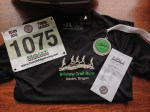 My race medal, tech shirt, bib and print out showing my 1st place age group finish!