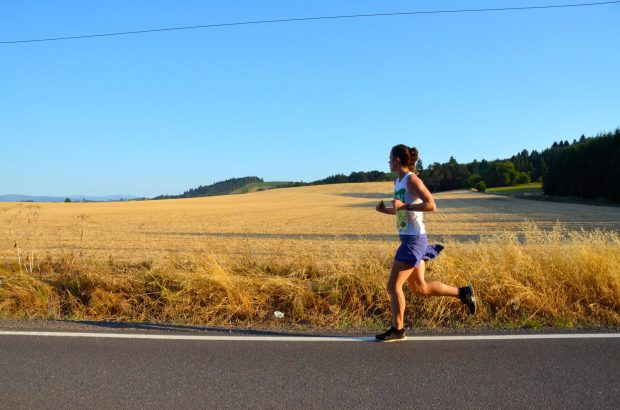 A solo runner glides through the Willamette Valley at the Oregon Wine Country Half Marathon. © 2013 Destination Races