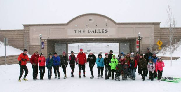Runners meeting at what would have been the start of the 2014 Jumpstart Valentine's Day Run in The Dalles on Saturday, February 8. The race was canceled due to weather.