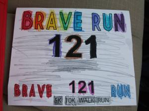 One of the hand-customized race bibs from the 2013 race, decorated by Banks Elementary students.