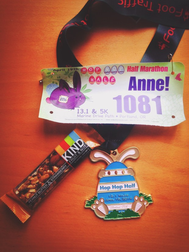The Finisher's Medal and race bib from the 2014 Hop Hop Half Marathon and 5k.