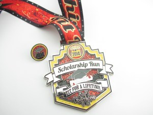 Race swag: the Scholarship Run finisher's medal with detachable pin (photo by Darwin Rasmussen)