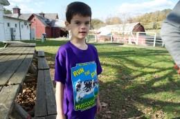 Sawyer models the kids shirt