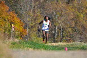 Dwayne Penny Alexis crests the final hill near the gazebo in the final half mile of the course (photo: Tom Casper). Click photo to view larger.