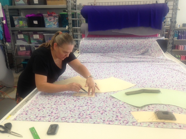 SSHQ Sewing Director Lady Mary working on a team order.
