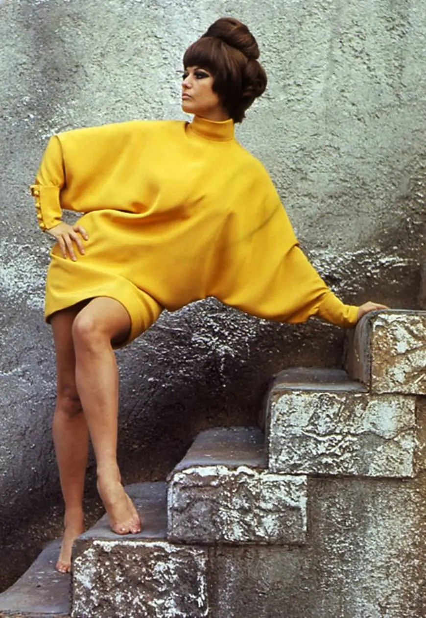 Claudia Cardinale 1960s mod vintage fashion style color photo print ad model magazine yellow bat sleeves