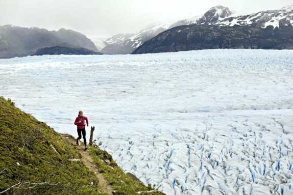 Elinor Fish running above the Grey Glacier while on a running tour of the Torres del Paine circuit in Patagonia, Chile.