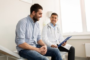 Man discussing a vasectomy with his urologist
