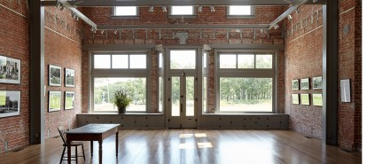 The Gallery is an open space in the Volland Store that rises to the roofline, revealing the original second-story windows.