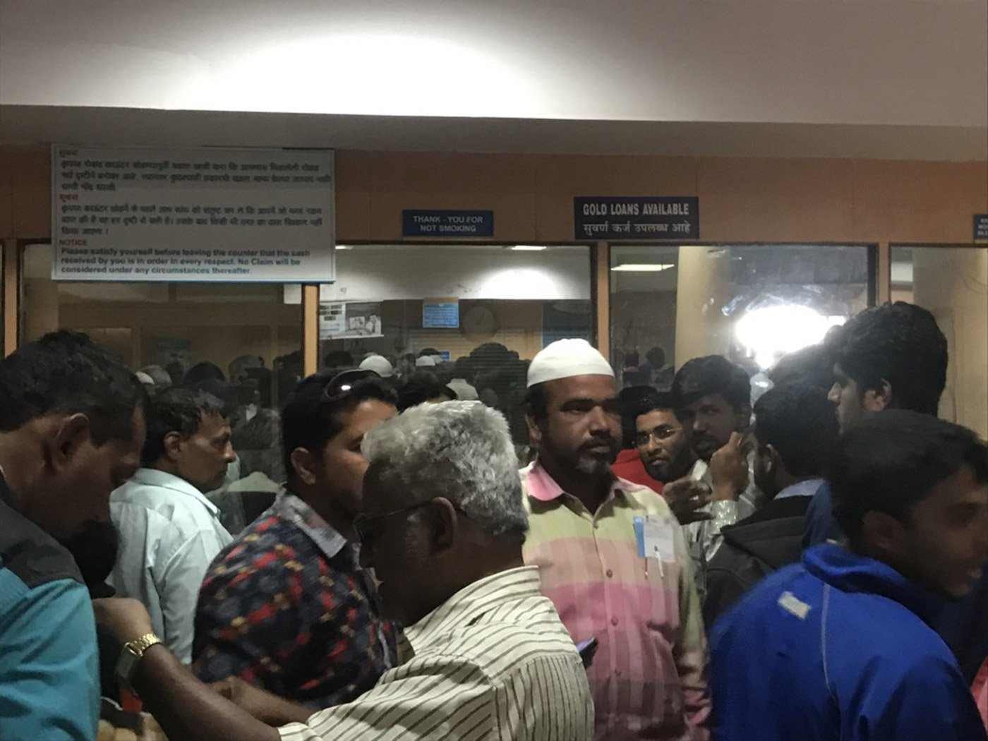 Frustrated members of the public throng the inside of the Shahganj branch of the State Bank of Hyderabad. Outside, the queue is nearly a kilometre long