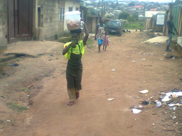 Child hawking snacks to make ends meet