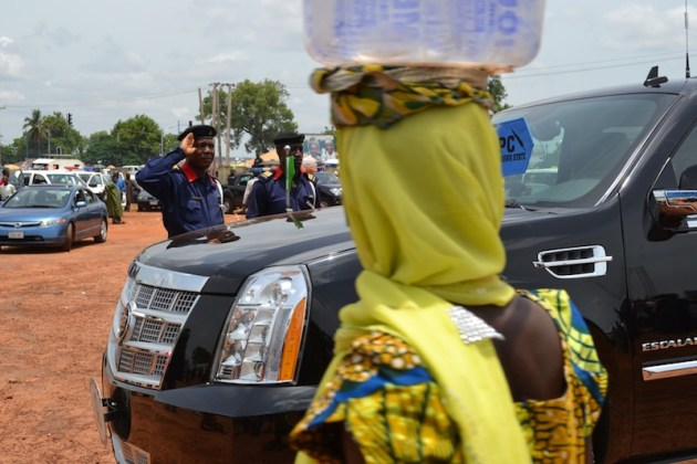 This photo was taken during a May Day parade organized in Nasarawa state. I was photographing the different speakers when I turned for a minute to see a scene that made a huge impression on me. First, there is the bigman's car with a security official saluting the politician inside, while a child hawking pure-water walks along. Re-imagine Nigeria!