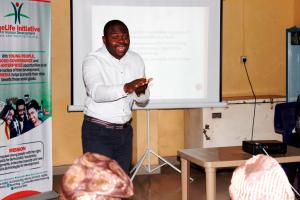 Dr. Femi Kuti during his session on Aflatoxin, farmers' Health and Occupational Safety in Oyo