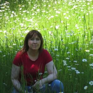 Susan Fluegel in a field of wild flowers.