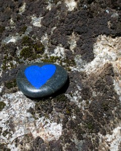 Blue heart painted on rock.