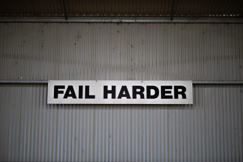 Don't Be Afraid To Fail. Image shows a sign that says, Fail Harder.