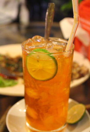 The ice lemon tea opposite (note grilled frog in background)