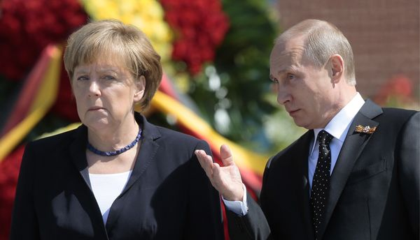 President Putin and Chancellor Merkel laying flowers at Tomb of Unknown Soldier by Moscow's Kremlin Wall