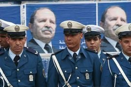 Policemen stand guard during Algerian President Abdelaziz Bouteflika's election campaign in the eastern city of Canstantine