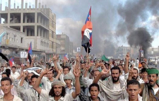 Protesters march during an anti-government demonstration in Radfan, a district in the southern Yemeni province of Lahej