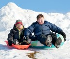 Elliott Hill, 8 and Bjorn Sandberg, 8, both of Auburn and students at Sherwood Heights Elementary School , scream as they fly down the hill next to the Auburn school Saturday afternoon. They have been waiting all vacation to go sledding, and with the cold weather hardening the recent snow, the conditions were finally perfect.