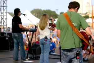 Russell & Kristi, along with their band, perform during Beachfest