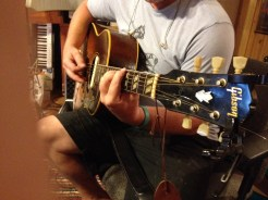 Mark playing Russell's vintage Gibson SJ Acoustic guitar