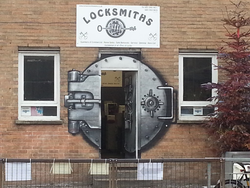 Locksmith with a painted on safe door