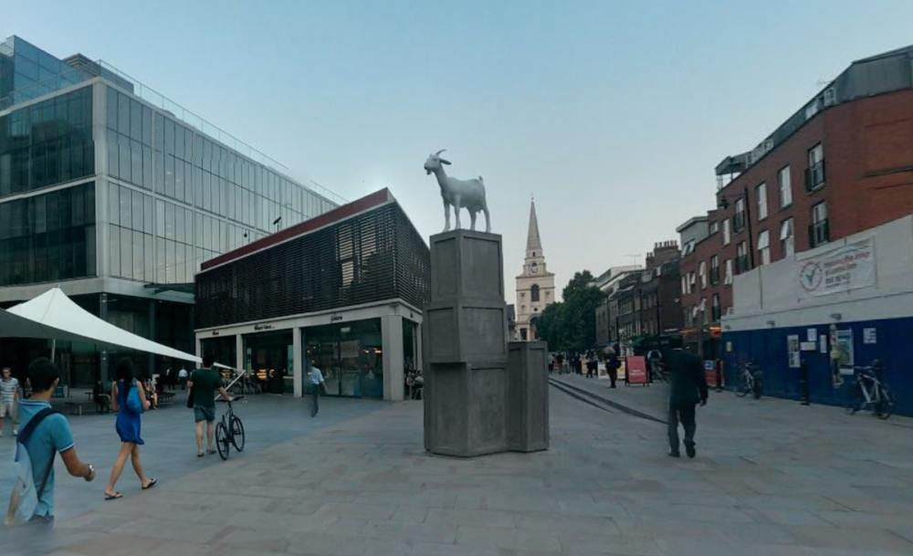 A goat on top of boxes in Old Spitalfields Market