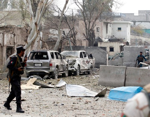 Afghan policemen take position during the gunfire in front of the Indian consulate in Jalalabad, Afghanistan March 2, 2016