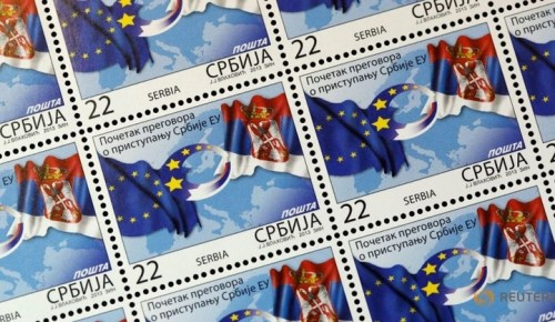 Special edition postage stamps show Serbia and EU flags, in Belgrade January 21, 2014.