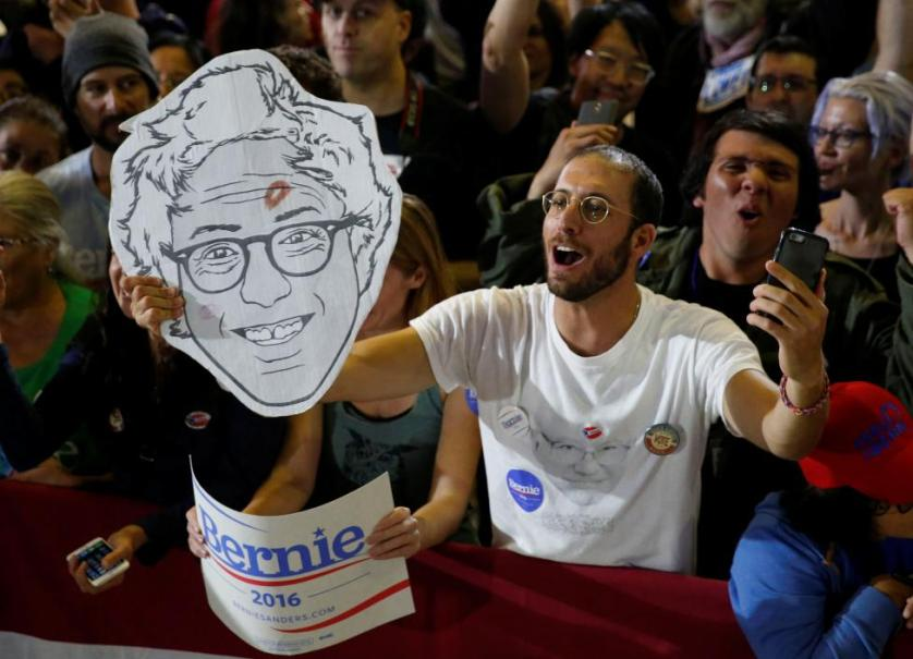 Supporters cheer as Bernie Sanders addresses supporters following the closing of the polls in the California presidential primary in Santa Monica, California, June 7, 2016. REUTERS/Lucy Nicholson