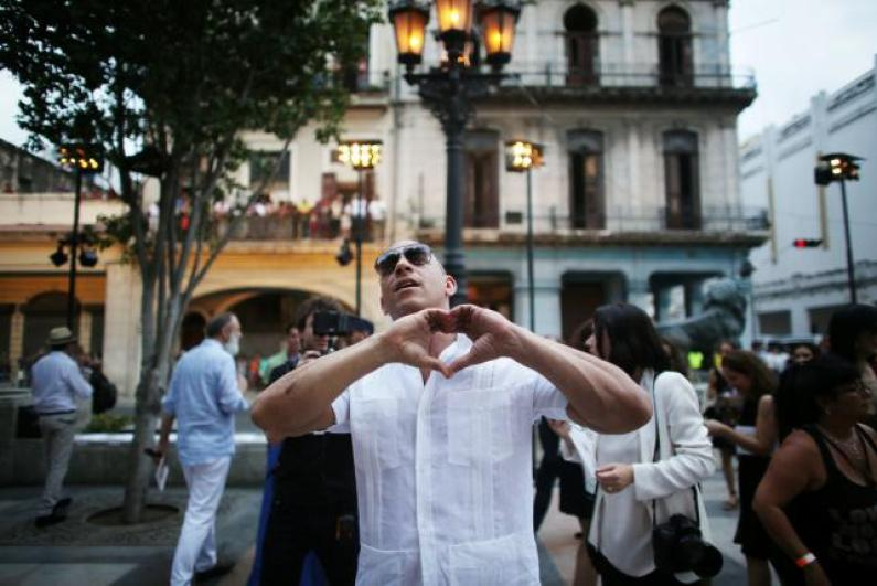 Actor Vin Diesel gestures to the public before a fashion show by German designer Karl Lagerfeld as part of his latest inter-seasonal Cruise collection for fashion house Chanel at the Paseo del Prado street in Havana, Cuba, May 3, 2016. REUTERS/Alexandre Meneghini