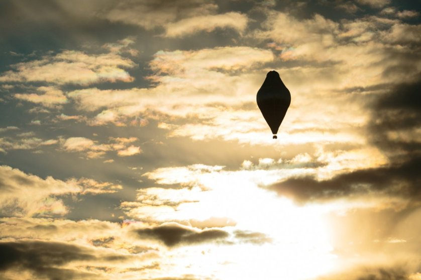 The balloon of Russian adventurer Fedor Konyukhov is seen after lift off in attempt to break the world record for a solo hot air balloon flight around the globe
