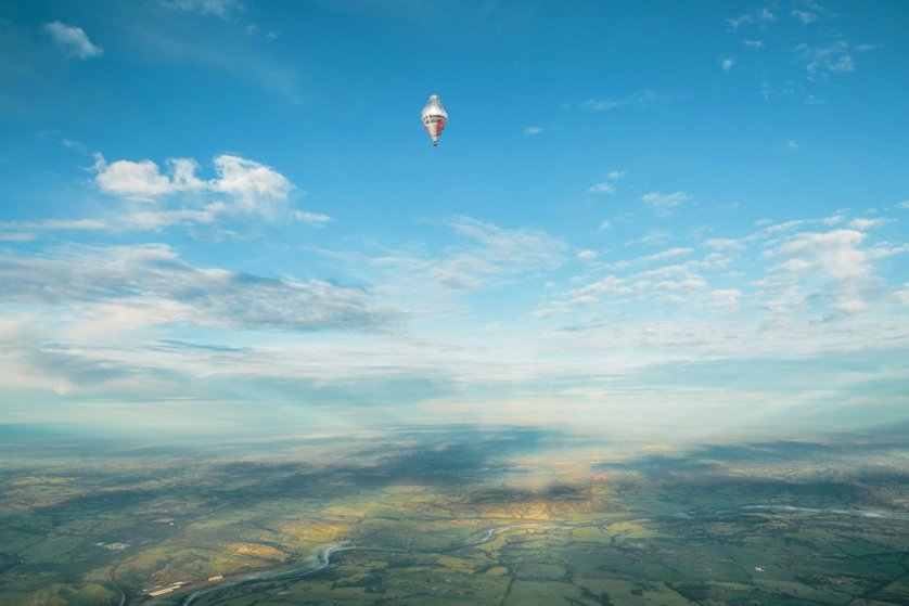 The balloon of Russian adventurer Fedor Konyukhov appears in the distance