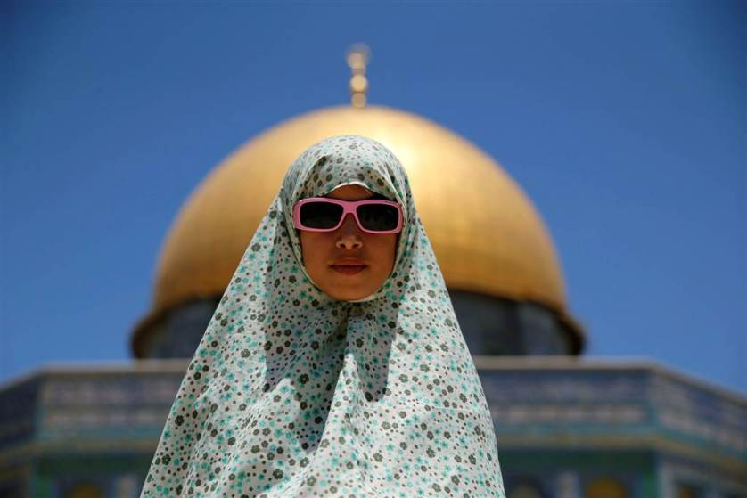 A Palestinian girl prays on the last Friday of the holy fasting month of Ramadan on the compound known to Muslims as Noble Sanctuary and to Jews as Temple Mount in Jerusalem's Old City on July 1.
