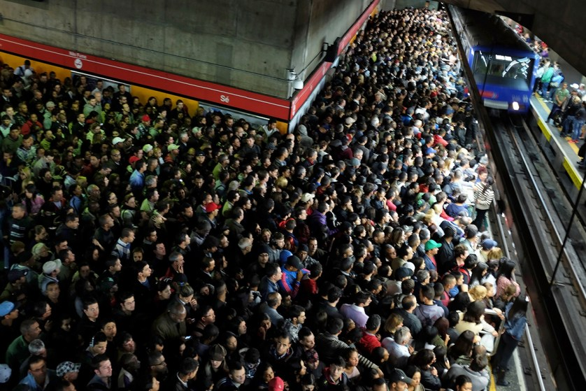 Commuters wait for a train at a subway station in Sao Paulo, Brazil