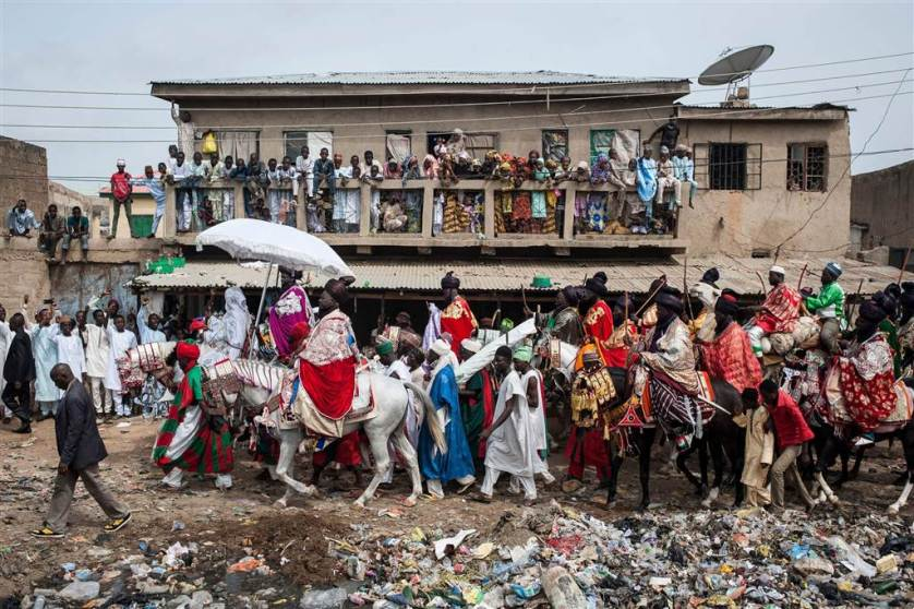 The Emir of Kano, Muhammadu Sanusi II, rides a horse as he parades with his entourage and musicians on the streets of Kano, northern Nigeria on July 6, during the Durbar Festival celebrating the Eid al-Fitr which marks the end of the Islamic holy fasting month of Ramadan.
