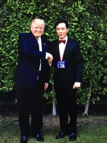 Donald Trump shakes hand with CAFT founder David Wang Tian. Photo: Courtesy of David Wang Tian
