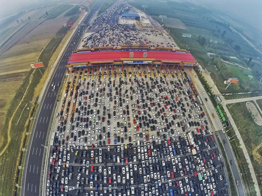 A traffic jam near a toll station on a huge highway as people return home at the end of a week-long national day holiday, in Beijing, China, on 6 October 2015