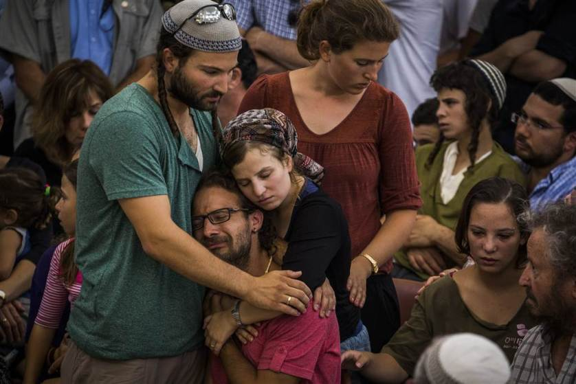 Relatives and friends of Rabbi Michael Mark mourn during his funeral on July 3 in Otniel, West Bank. Rabbi Michael Mark was shot and killed, and his wife and two children injured in a drive-by terrorist attack on his family car on route 60 in the West-Bank.