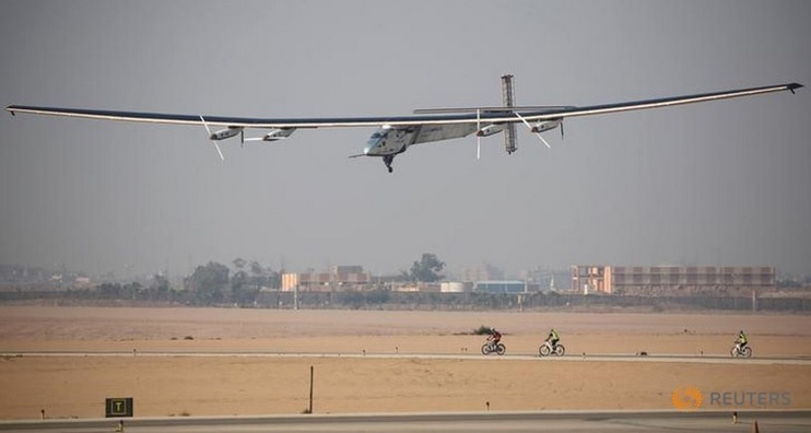 Solar Impulse 2, a solar powered plane piloted by Swiss aviator Andre Borschberg, is seen as it prepares to land at Cairo Airport, Egypt July 13, 2016