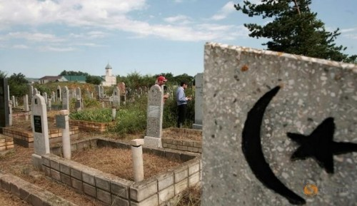 Local residents attend a prayer at the cemetery in the village of Ikon-Khalk in Dagestan, Russia, July 5, 2016. Picture taken July 5, 2016.