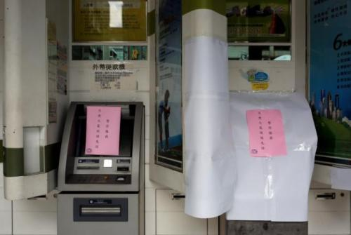 Taiwanese First Bank automated teller machines are seen suspended after T$70 million was reported stolen from its automated teller machines (ATM) in Taipei, Taiwan July 13, 2016.