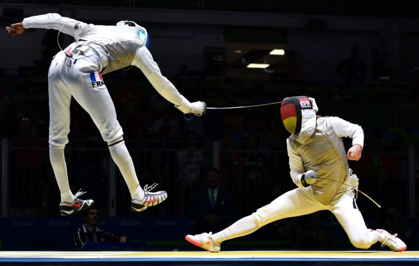 Germany's Peter Joppich (R) competes against France's Enzo Lefort during their mens individual foil qualifying bout as part of the fencing event of the Rio 2016 Olympic Games, on August 7, 2016, at the Carioca Arena 3, in Rio de Janeiro. / AFP PHOTO / Fabrice COFFRINIFABRICE COFFRINI/AFP/Getty Images ORIG FILE ID: AFP_E02US